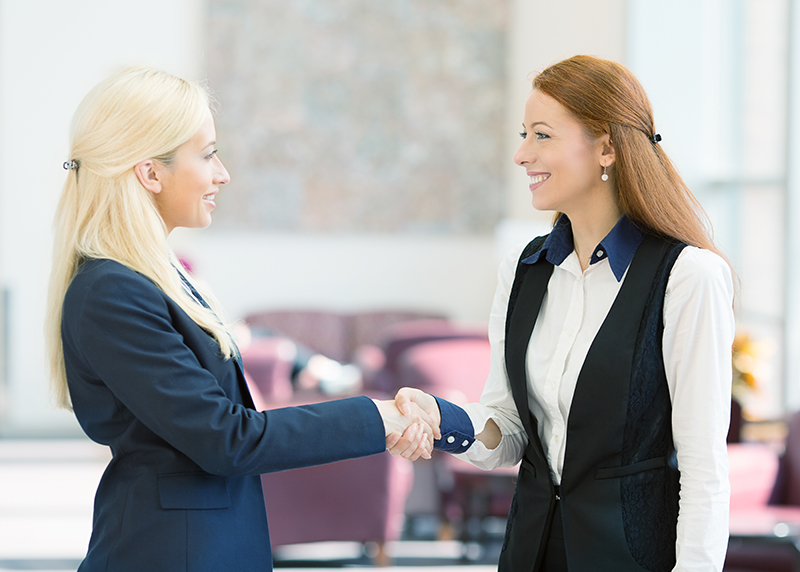 Two-business-women-shaking-hands